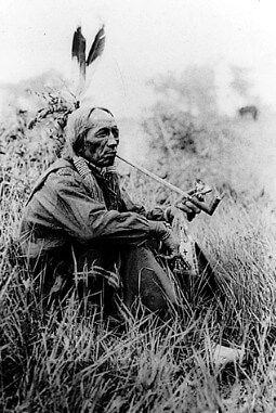 Native American Smoking A Pipe